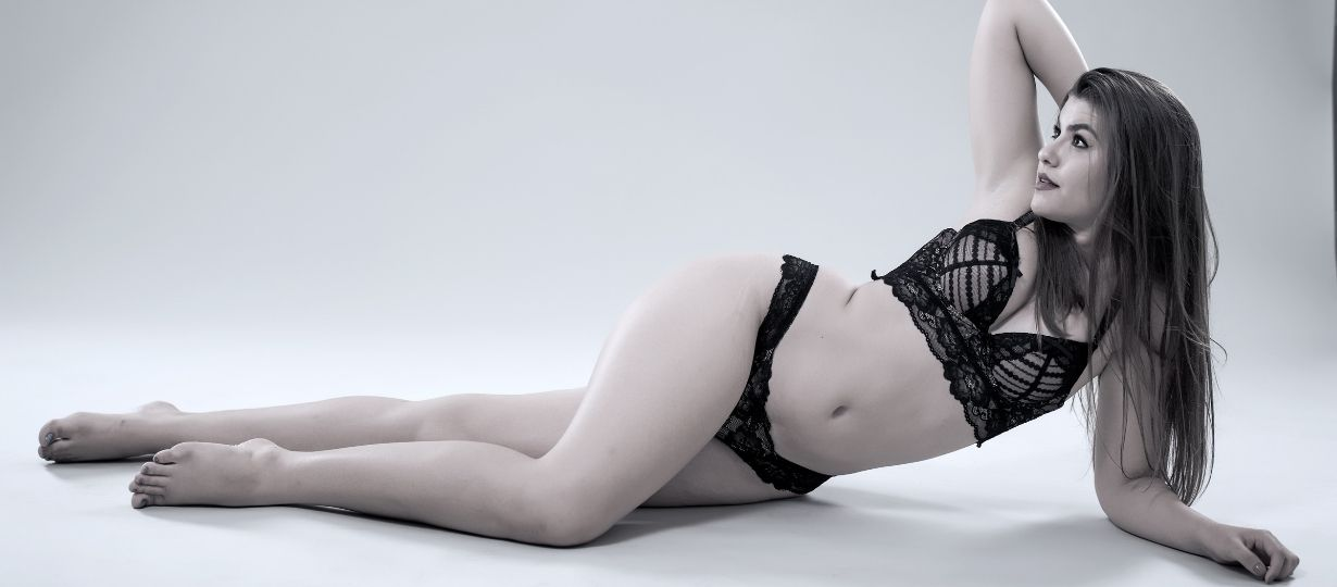 Curvy women wearing black plus sized sexy lingerie in seductive position
