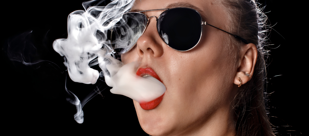 Beautiful young lady wearing shades making large vapour out of her mouth.The Most Affordable Vaping Kits