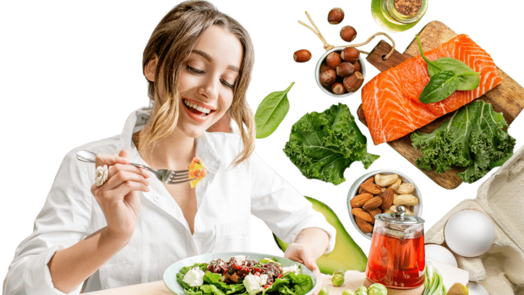 Easy Keto Diet Image – Young smiling woman with curly blonde hair and wearing white polo eating keto diet salad using silver fork. Young woman surrounded with keto-friendly food like nuts, eggs, salmon and green leafy vegetables.
