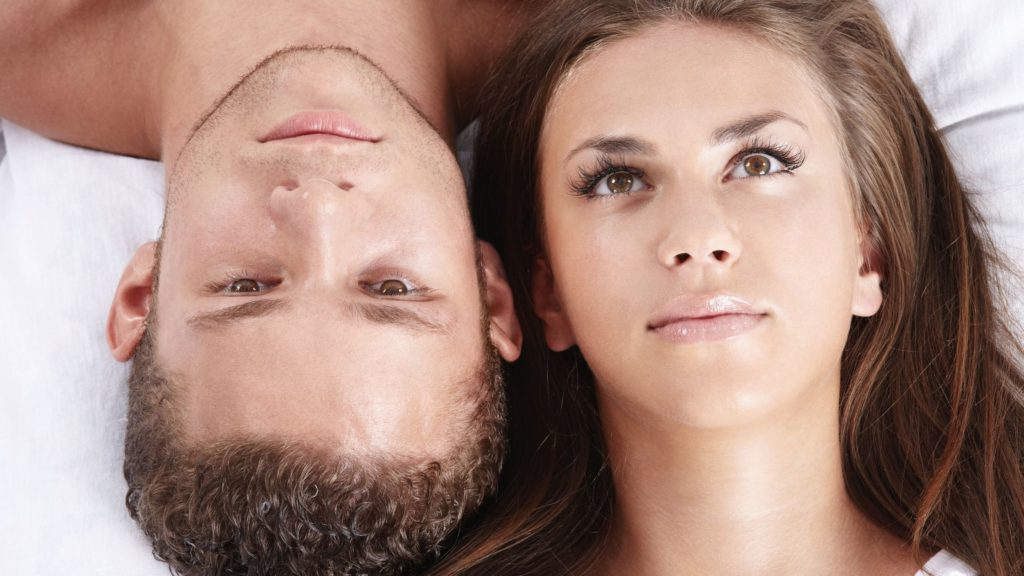 woman's and man's face, lying and looking up in a dreaming expression, they look beautiful, she has long brown hair and he short hair, both have beautiful lips and brown eyes, this photo belongs to the article called 'how to improve mind and how to improve body'