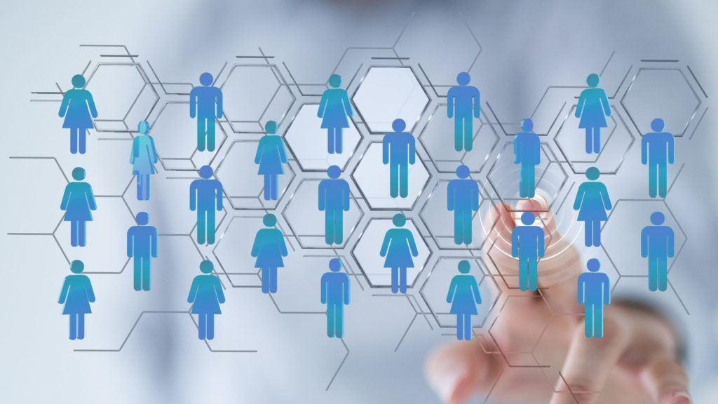 Best Facebook group strategies image shows blue human graphics digitally connected through social media. Image shows a hand clicking the illustration of several blue human graphics.